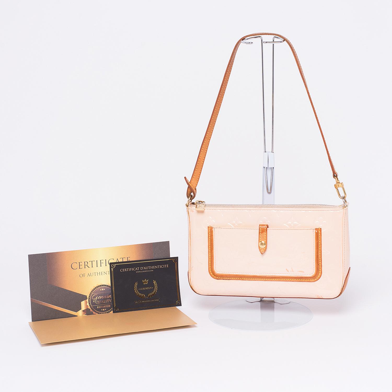 Pochette Louis Vuitton Mallory Authentique d'occasion en cuir vernis rose pale