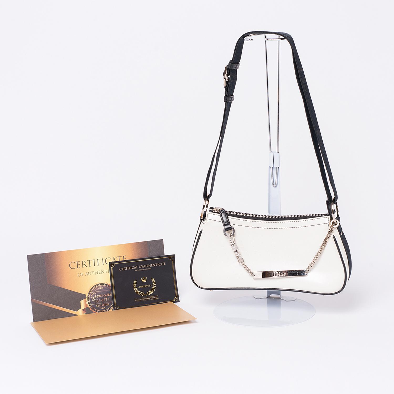 Pochette Dior bijoux Swarovski Authentique d'occasion en cuir blanc avec finitions noires