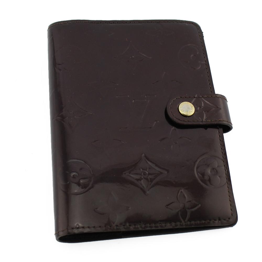 Porte-agenda Louis Vuitton monogram empreinte Authentique d'occasion en cuir vernis couleur amarante (mauve)