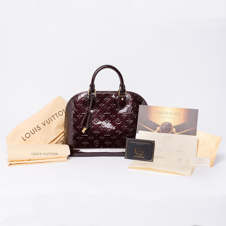 Sac à main Louis Vuitton Alma PM Amarante Authentique d'occasion en cuir vernis monogram empreinte