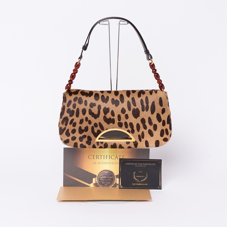Ravissant Sac Christian Dior Malice Authentique d'occasion en poulain imprimé façon léopard