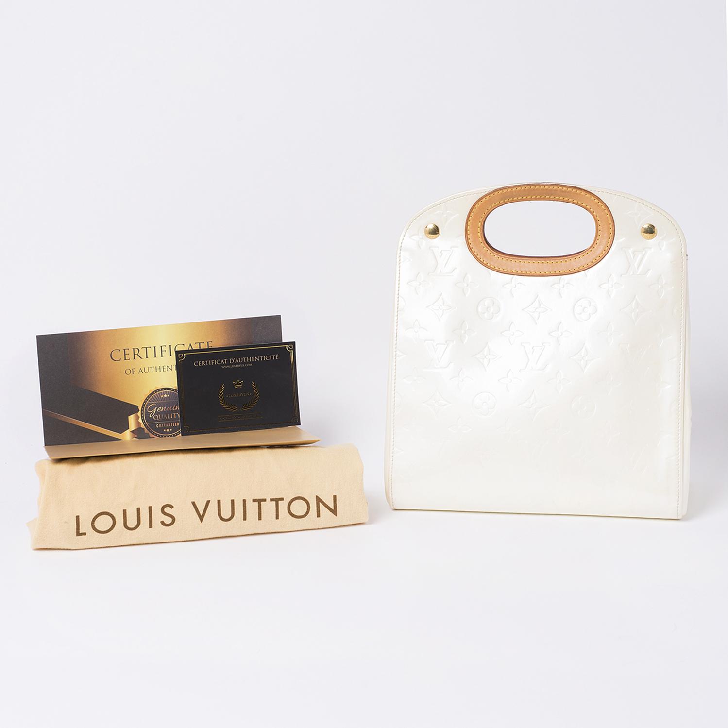 Sac Louis Vuitton Authentique d'occasion en cuir vernis monogram empreint couleur crème