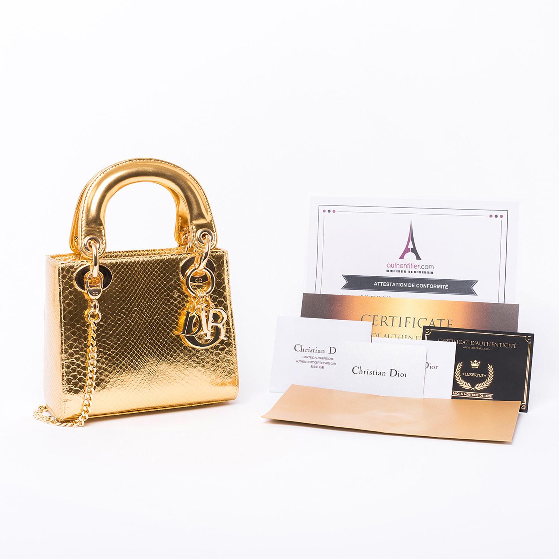 Sac à main Mini Lady Dior Authentique d'occasion en cuir Python couleur or. Modèle exceptionnel
