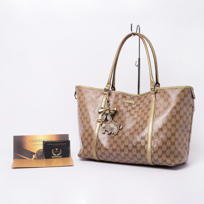 Sac cabas Gucci monogram dorée Authentique d'occasion avec porte-clés Gucci Dog motifs Guccissima