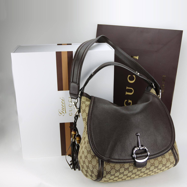 Sac à main / sac à bandoulière Gucci Authentique d'occasion en toile monogram et cuir grainé