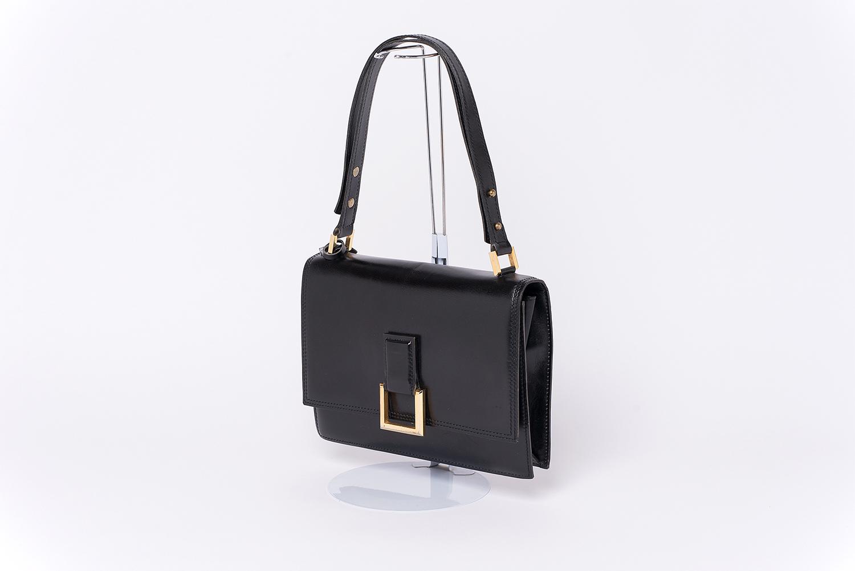 Sac à main Delvaux Vintage Authentique d'occasion en cuir couleur noir et bijouterie dorée
