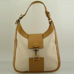 Sac à épaule Gucci modèle Jackie Authentique d'occasion en toile beige et cuir camel