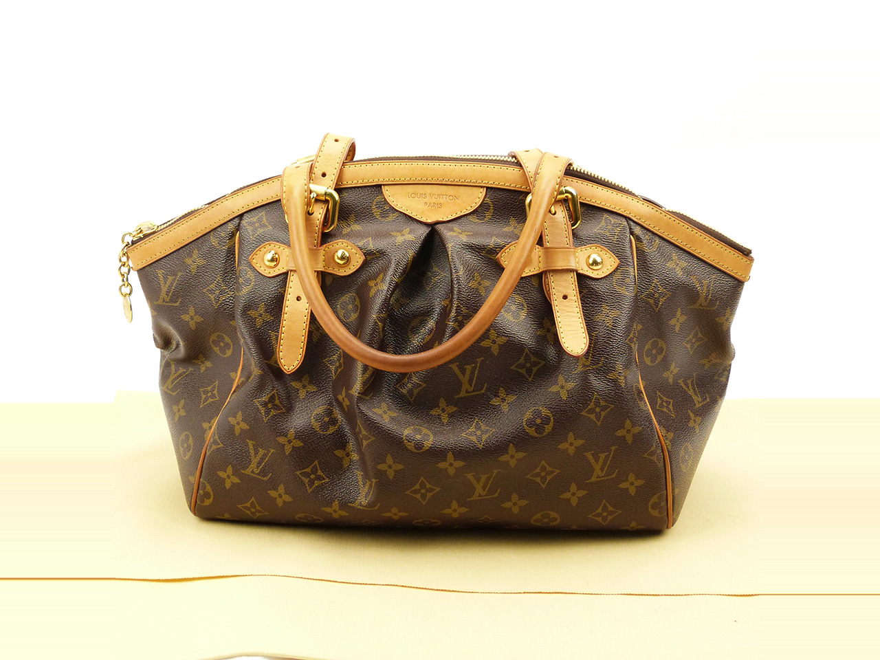 Sac à main Louis Vuitton Tivoli GM Authentique d'occasion ajustable en toile Monogram