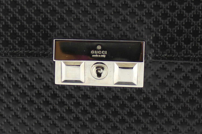 Porte-documents Gucci Authentique d'occasion en cuir couleur noir, bijouterie argentée. Modèle 2018