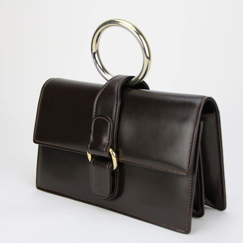 Pochette Gucci VINTAGE Authentique d'occasion en cuir signature GUCCI pour G.DEBY BRUXELLES