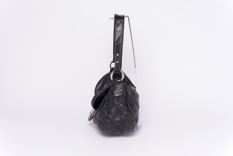 Sac à rabat Chanel On the Road Authentique d'occasion en cuir matelassé noir
