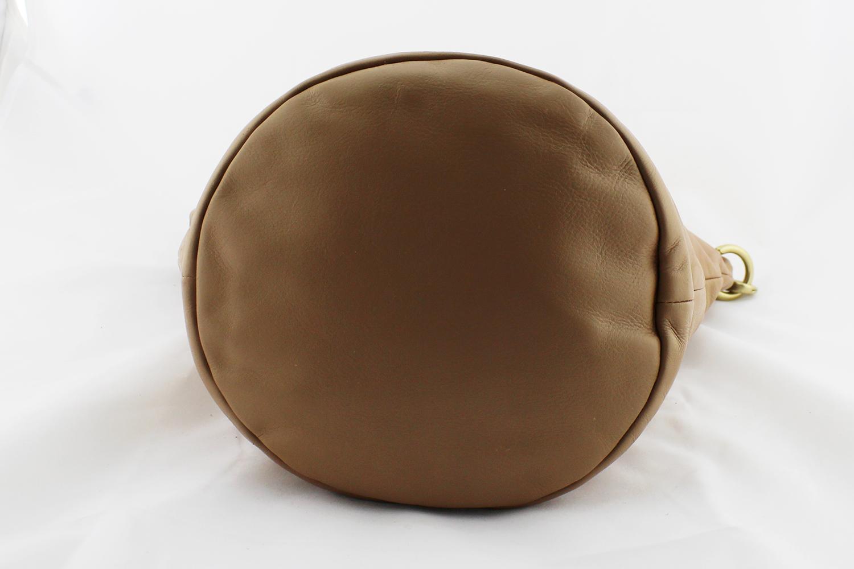 Sac à main Chanel Seau Authentique d'occasion en cuir grainé souple couleur beige