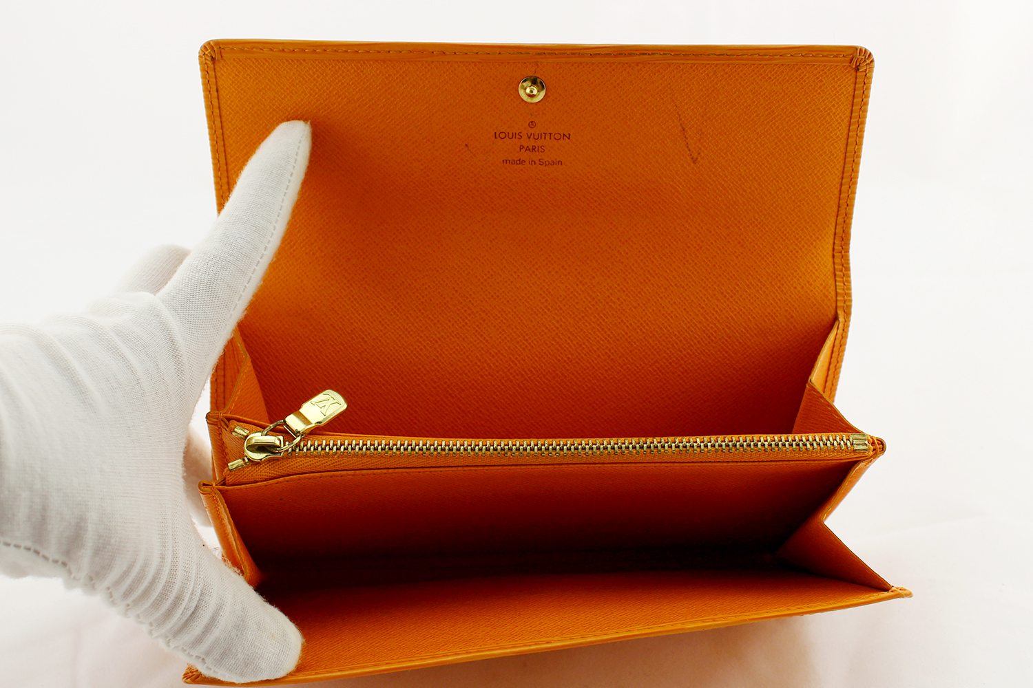 Portefeuille Louis Vuitton Sarah Authentique d'occasion en cuir épi couleur orange