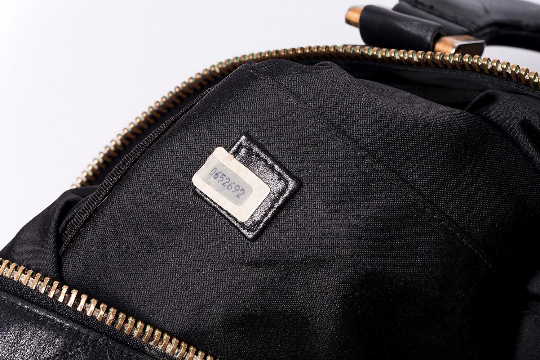 Sac de voyage Chanel Boston 50 Authentique d'occasion en cuir matelassé noir